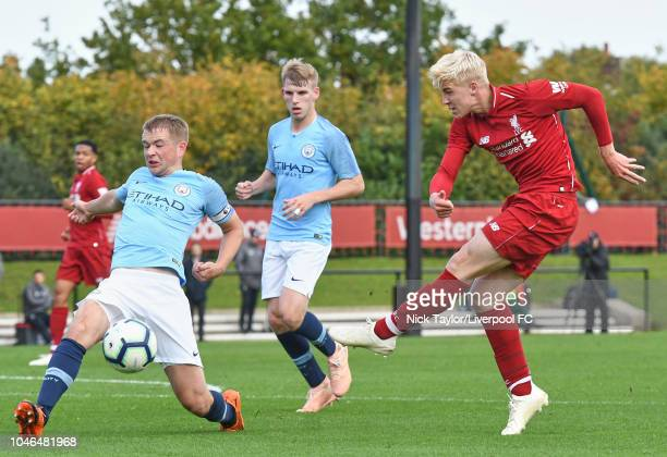 Luis Longstaff of Liverpool has his shot blocked by Rowan McDonald of Manchester City in action during the U18 Premier League match between Liverpool...