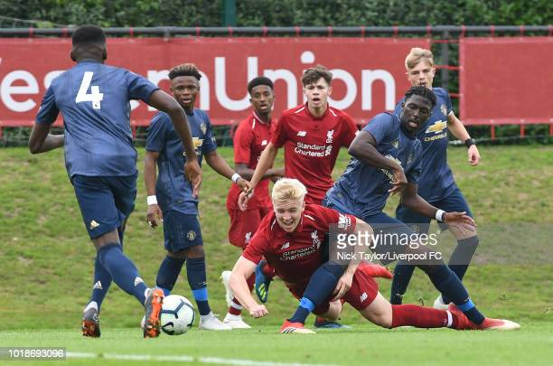 Luis Longstaff of Liverpool is brought down by Ethan Laird of Manchester United during the Liverpool U18 v Manchester United U18 game at The Kirkby...