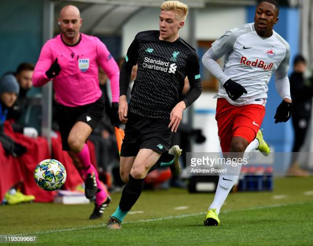 Luis Longstaff of Liverpool with Bryan Okoh of RB Salzburg U19 during the UEFA Youth League match between RB Salzburg U19 and Liverpool U19 on...