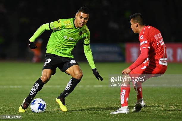 Luis Lopez of Juarez controls the ball against Daniel Alvarez of Necaxa during the 5th round match between FC Juarez and Necaxa as part of the Torneo...