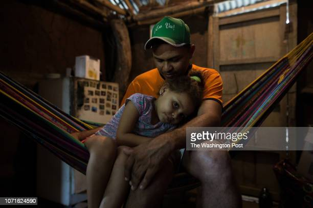 Luis Lucho Salgado and his daughter Karen six He says he prefers not to talk about what happened the day of the massacre for many people it remains...