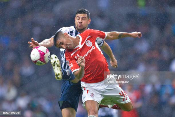 Luis Madrigal of Monterrey fights for the ball with Alexis Gonzalez of Toluca during the 13th round match between Monterrey and Toluca as part of the...