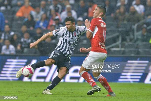 Luis Madrigal of Monterrey kicks the ball towards Alexis Gonzalez of Toluca during the 13th round match between Monterrey and Toluca as part of the...