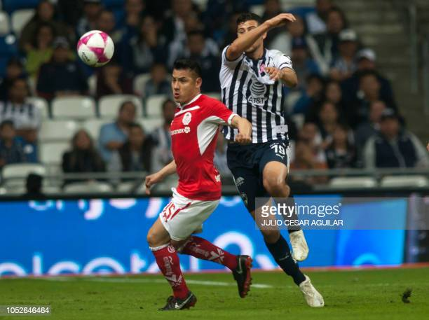 Luis Madrigal of Monterrey vies for the ball with Antonio Rios of Toluca during their Mexican Apertura 2018 tournament football match in Monterrey...
