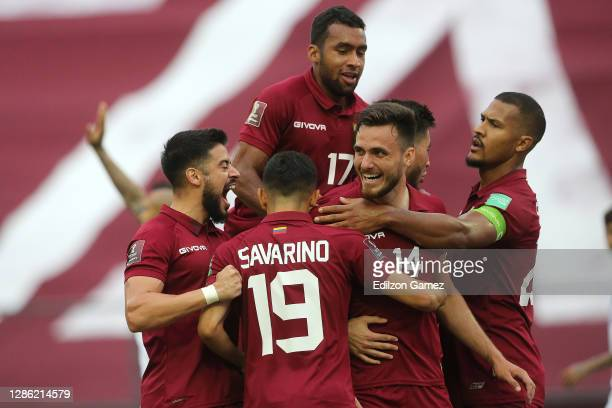 Luis Mago of Venezuela celebrates with teammates after scoring the first goal of his team during a match between Venezuela and Chile as part of South...