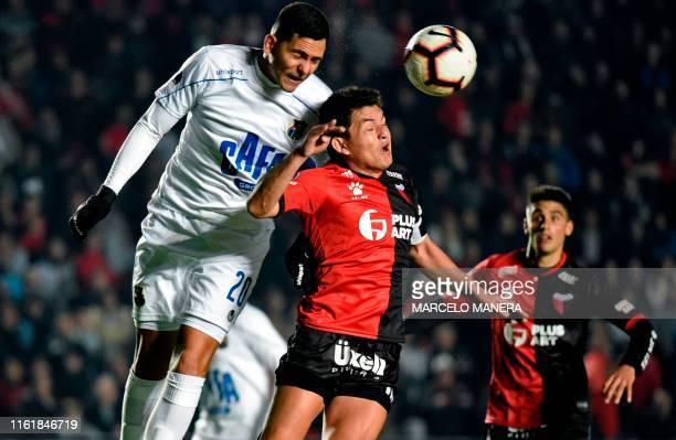 Luis Maria Rodriguez of Argentina's Colon de Santa Fe and Andres Maldonado of Venezuela's Zulia FC jump for the ball during their Copa Sudamericana...