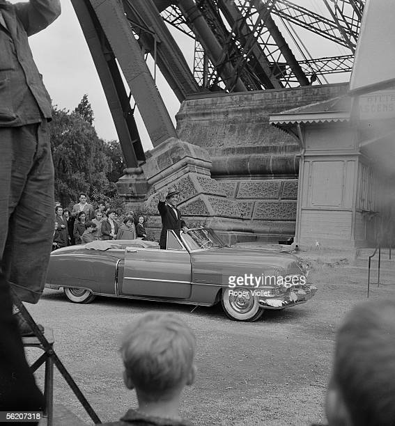 Luis Mariano Spanish singer and actor greeting crowd with her arrival in convertible Cadillac with a reception with the Eiffel tower Paris June 17...
