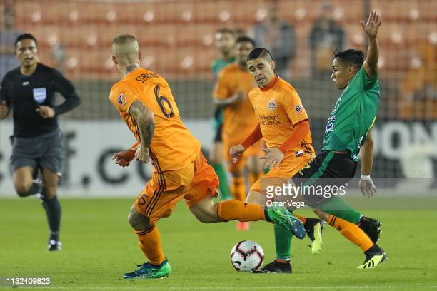 Luis Martinez of CD Guastatoya and Aljaz Struna of Houston Dynamo fight the ball during the match between Houston Dynamo and CD Guastatoya as part of...