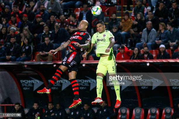 Luis Martinez of Tijuana and Anderson Santamaria of Atlas fight for the ball during the 9th round match between Tijuana and Atlas as part of the...