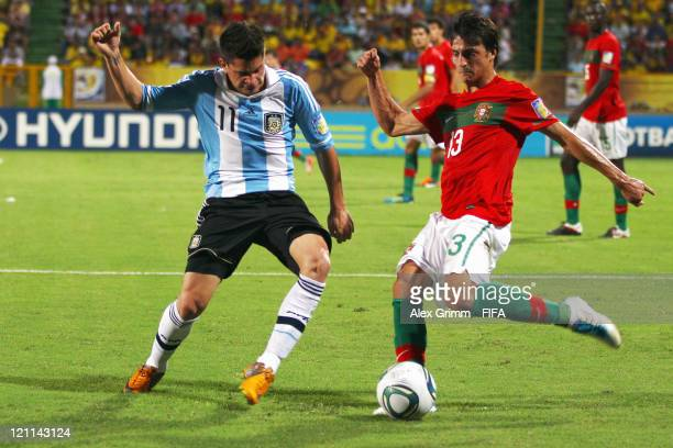 Luis Martins of Portugal is challenged by Juan Iturbe of Argentina during the FIFA U20 World Cup 2011 quarter final match between Portugal and...