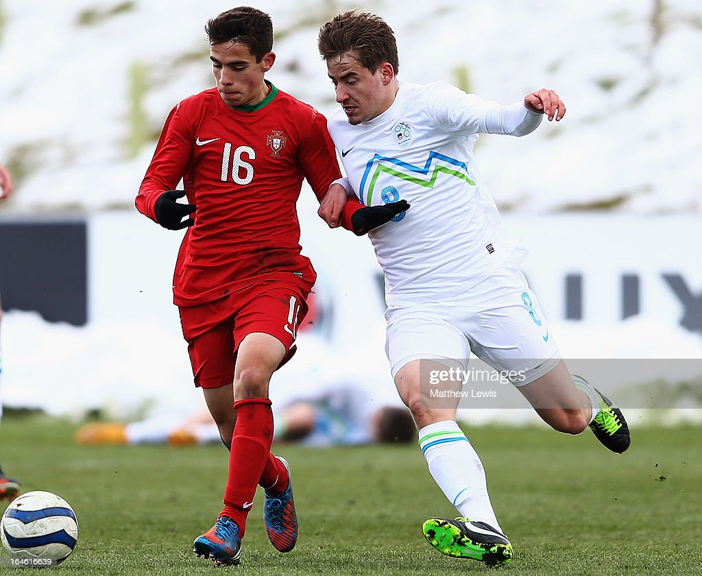 Luis Mata of Portugal and Nik Lobek of Slovenia challenge for the ball during the UEFA European Under-17 Championship Elite Round match between Slovenia and Portugal at St George's Park on March 25, 2013 in Burton-upon-Trent, England.