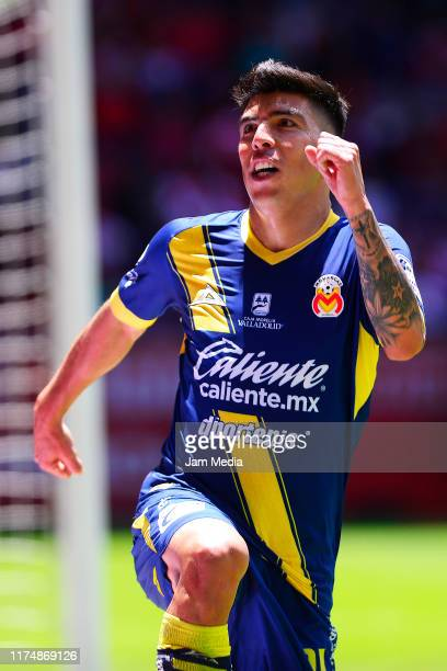 Luis Mendoza of Morelia celebrates after scoring the first goal of his team during the 9th round match between Toluca and Morelia as part of the...