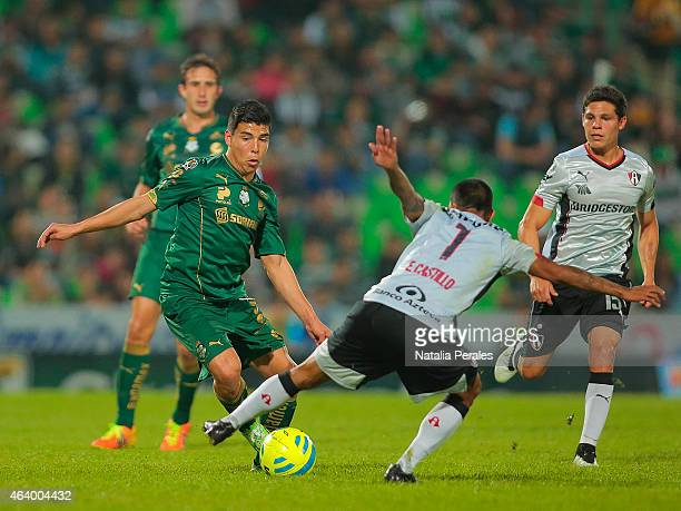 Luis Mendoza of Santos tries to dribble Edgar Castillo of Atlas during a match between Santos Laguna and Atlas as part of 7th round Clausura 2015...
