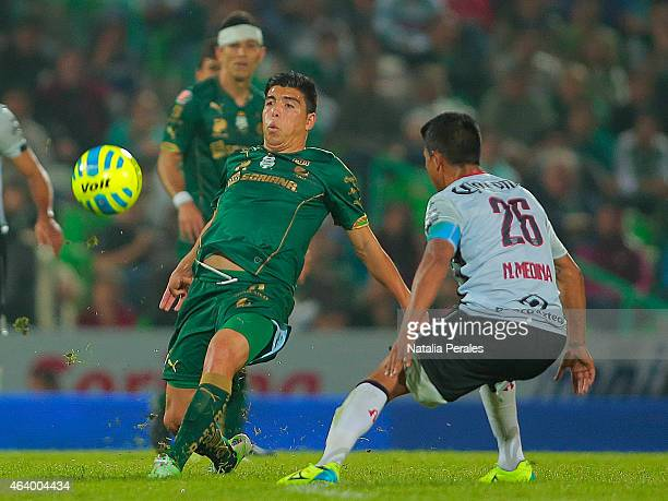 Luis Mendoza of Santos tries to dribble Juan Carlos Medina of Atlas during a match between Santos Laguna and Atlas as part of 7th round Clausura 2015...