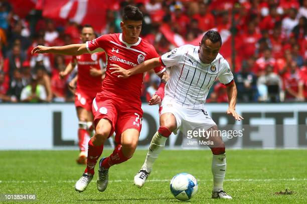 Luis Mendoza of Toluca and Edwin Hernandez of Chivas fight for the ball during the third round match between Toluca and Chivas as part of the Torneo...