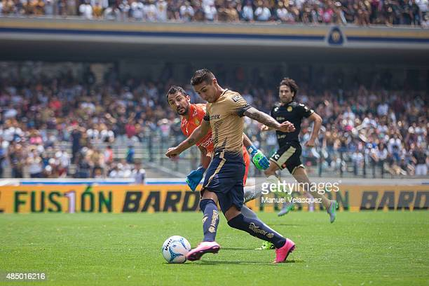 Luis Michel goalkeeper of Dorados struggles for the ball with Ismael Sosa of Pumas during a 6th round match between Pumas UNAM and Dorados de Sinaloa...