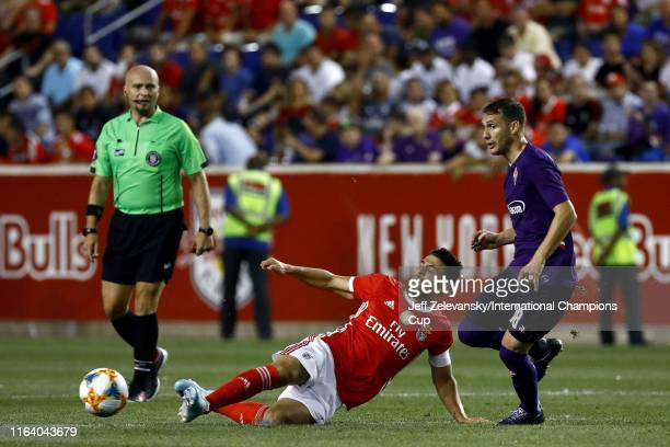 Luis Miguel Afonso Fernandes of Benfica battles for the ball with Sebastian Cristoforo of Fiorentina during the International Champions Cup match at...