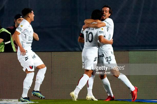 Luis Miguel Rodríguez of Colon celebrates with teammate Cristian Bernardi after scoring the first goal of his team during a semifinal match of Copa...