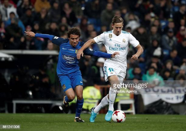 Luis Milla Manzanares of Fuenlabrada in action against Marcos Llorente of Real Madrid during King's Cup soccer match between Real Madrid and...