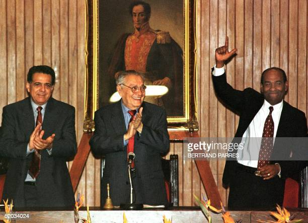 Luis Miquilena , president of Venezuela's constituent assembly, is flanked by his two vice presidents Isaias Rodriguez and Aristobulo Isturiz as they...