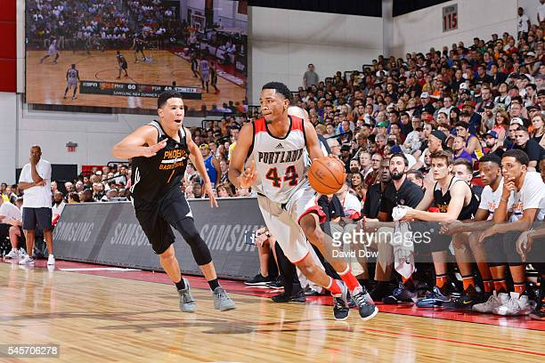 Luis Montero of the Portland Trail Blazers handles the ball against Devin Booker of the Phoenix Suns during the 2016 NBA Las Vegas Summer League game...