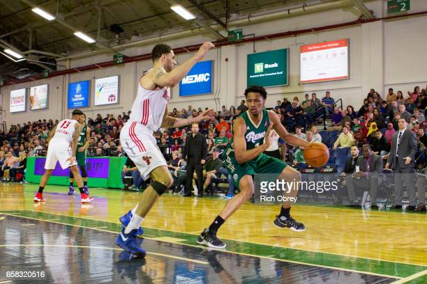 Luis Montero of the Reno Bighorns uses a dropstep fadeaway shot to get away from Abdel Nader of the Maine Red Claws on Sunday March 26 2017 at the...