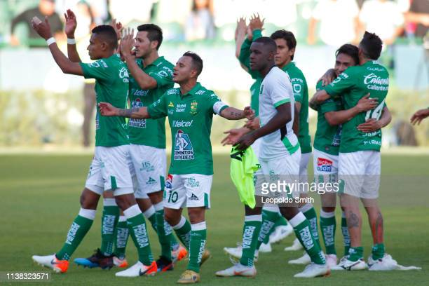 Luis Montes and his teammates celebrate the twelfth consecutive victory of their team a record in Liga MX after the 15th round match between Leon and...