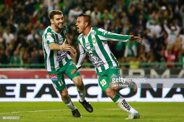 Luis Montes of Leon celebrates with teammate Mauro Boselli after scoring the second goal of his team during the second round match between Leon and...