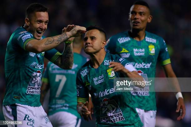 Luis Montes of Leon celebrates with teammates after scoring the first goal of his team during the 5th round match between Leon and Monterrey as part...