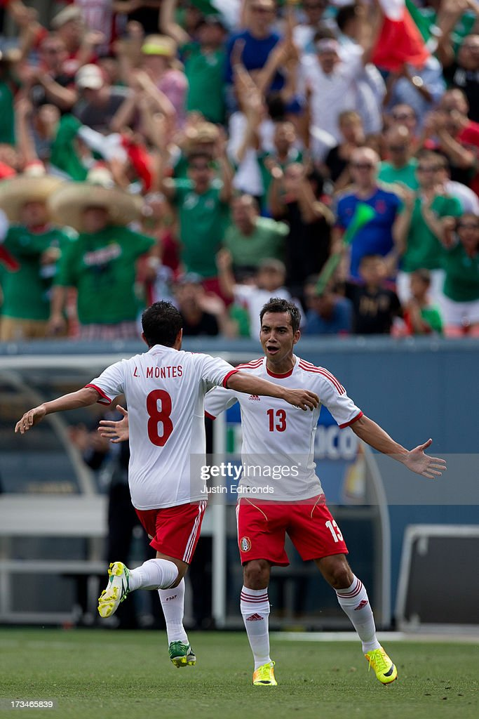 Luis Montes #8 of Mexico celebrates his goal with teammate Adrian Aldrete #13 during the first half of a CONCACAF Gold Cup match against Martinique at Sports Authority Field at Mile High on July 14, 2013 in Denver, Colorado.