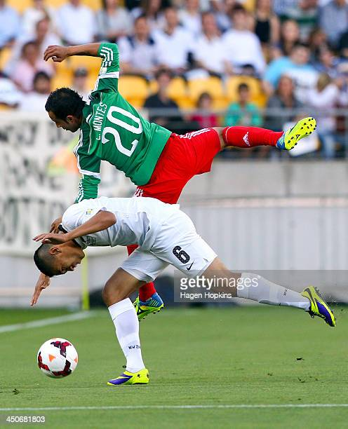 Luis Montes of Mexico challenges Bill Tuiloma of New Zealand for a header during leg 2 of the FIFA World Cup Qualifier match between the New Zealand...