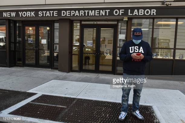 Luis Mora stands in front of the closed offices of the New York State Department of Labor on May 7 2020 in the Brooklyn borough in New York City 32...