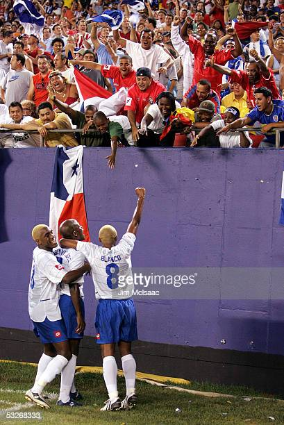 Luis Moreno Jorge Luis Dely Valdes and Alberto Blanco of Panama celebrate a goal by Valdes against Colombia during the CONCACAF Gold Cup semifinal...