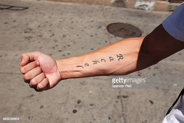 """Luis Moure, who was once addicted to K2 or """"spice"""", a synthetic marijuana drug, shows off a tattoo in East Harlem on August 5, 2015 in New York City...."""