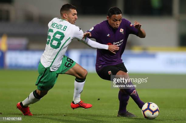 Luis Muriel of ACF Fiorentina battles for the ball with Medhi Bourabia of US Sassuolo during the Serie A match between ACF Fiorentina and US Sassuolo...