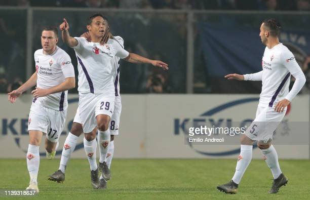 Luis Muriel of ACF Fiorentina celebrates with his teammates after scoring the opening goal during the TIM Cup match between Atalanta BC and ACF...