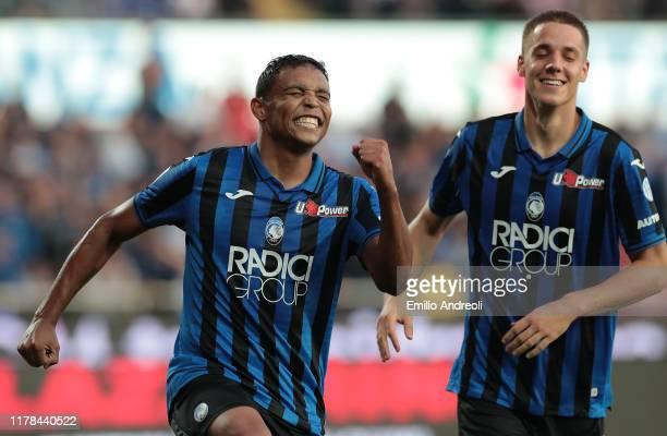 Luis Muriel of Atalanta BC celebrates his third goal with his team-mate Mario Pasalic during the Serie A match between Atalanta BC and Udinese Calcio...
