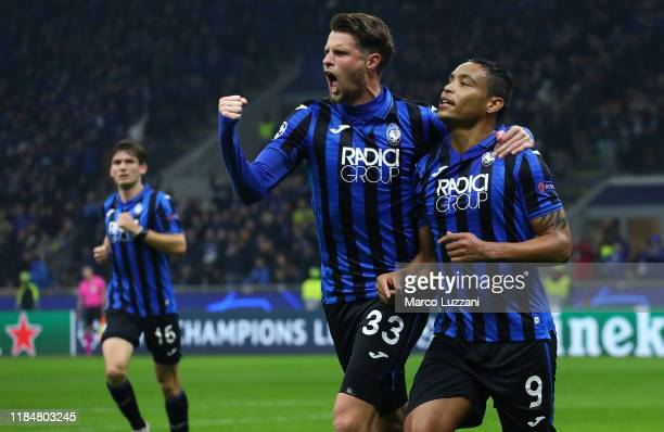 Luis Muriel of Atalanta BC celebrates with his teammate Hans Hateboer after scoring the opening goal during the UEFA Champions League group C match...