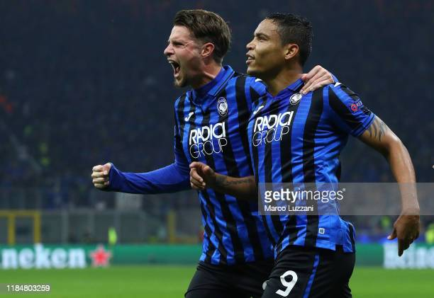 Luis Muriel of Atalanta BC celebrates with his team-mate Hans Hateboer after scoring the opening goal during the UEFA Champions League group C match...