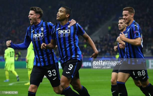 Luis Muriel of Atalanta BC celebrates with his teammates Hans Hateboer and Mario Pasalic after scoring the opening goal during the UEFA Champions...