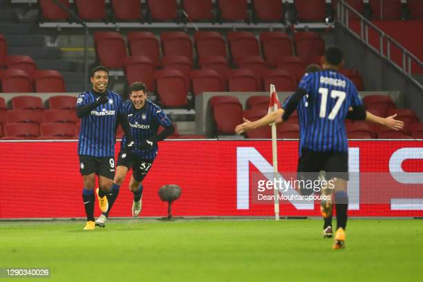 Luis Muriel of Atalanta B.C celebrates with team mate Matteo Pessina after scoring their sides first goal during the UEFA Champions League Group D...