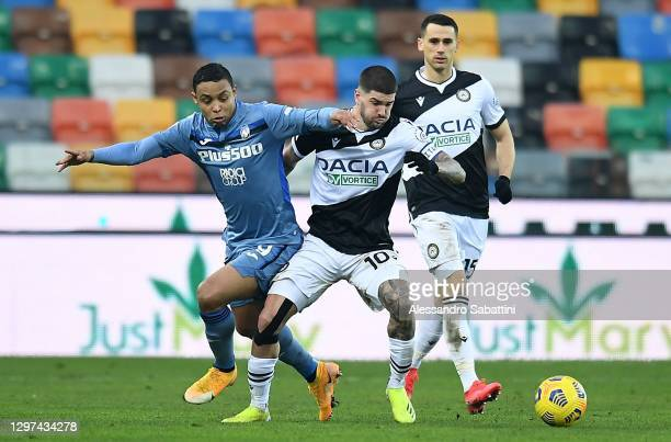 Luis Muriel of Atalanta BC competes for the ball with Rodrigo de Paul of Udinese Calcio during the Serie A match between Udinese Calcio and Atalanta...