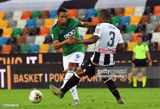 Luis Muriel of Atalanta BC competes for the ball with Samir of Udinese Calcio during the Serie A match between Udinese Calcio and Atalanta BC at...