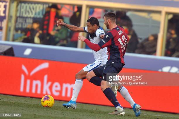 Luis Muriel of Atalanta BC competes the ball with Mattia Bani of Bologna FC during the Serie A match between Bologna FC and Atalanta BC at Stadio...