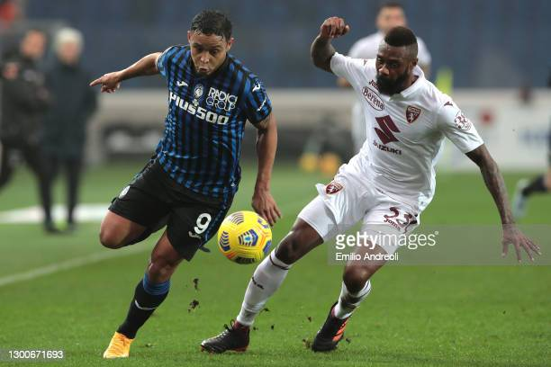 Luis Muriel of Atalanta B.C. Is challenged by Nicolas Nkoulou of Torino FC during the Serie A match between Atalanta BC and Torino FC at Gewiss...
