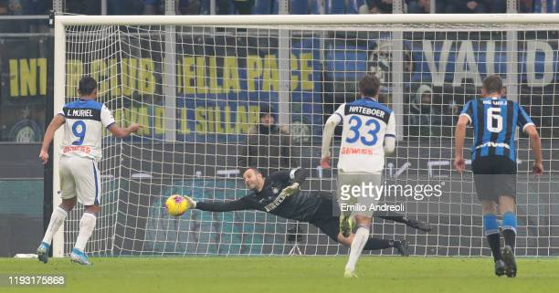 Luis Muriel of Atalanta BC kicks and misses the penalty that Samir Handanovic of FC Internazionale saves during the Serie A match between FC...