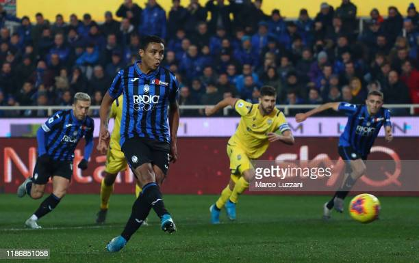 Luis Muriel of Atalanta BC scores his goal from the penalty spot during the Serie A match between Atalanta BC and Hellas Verona at Gewiss Stadium on...