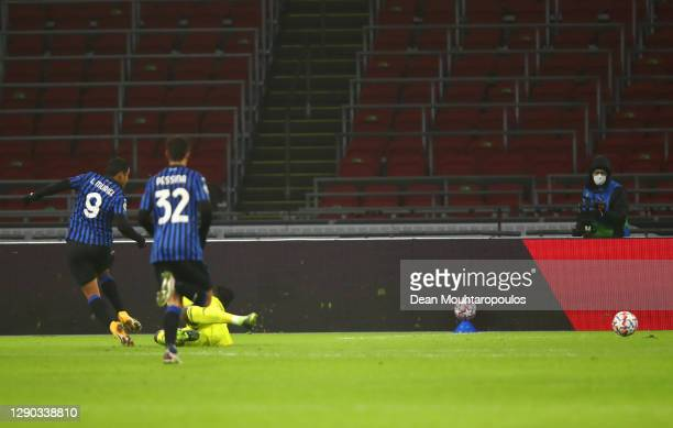 Luis Muriel of Atalanta B.C. Scores their team's first goal during the UEFA Champions League Group D stage match between Ajax Amsterdam and Atalanta...