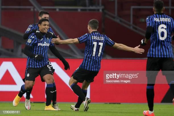 Luis Muriel of Atalanta Bergamo Celebrates 0-1 with Remo Freuler of Atalanta Bergamo during the UEFA Champions League match between Ajax v Atalanta...