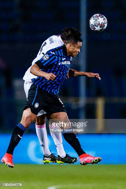 Luis Muriel of Atalanta fights for the ball with Raphael Varane of Real Madrid during the UEFA Champions League Round of 16 match between Atalanta...